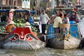 Cai Be Floating Market in Mekong Delta