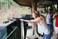 Try to fire the gun at Cu Chi Tunnels