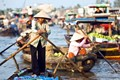 Cai Be floating market in Mekong Delta River